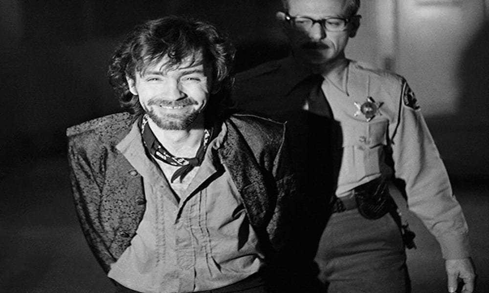 FILE - In this Dec. 21, 1970 file photo, a smiling Charles Manson goes to lunch after an outbreak in court that resulted in his ejection, along with three women co-defendants, from the his murder trial in Los Angeles. Manson was convicted in 1971 after jurors deliberated for 42 hours over nine days. He and the three co-defendants were convicted of a series of killings in the Los Angeles area, including that of actress Sharon Tate. (AP Photo/George Brich, File)