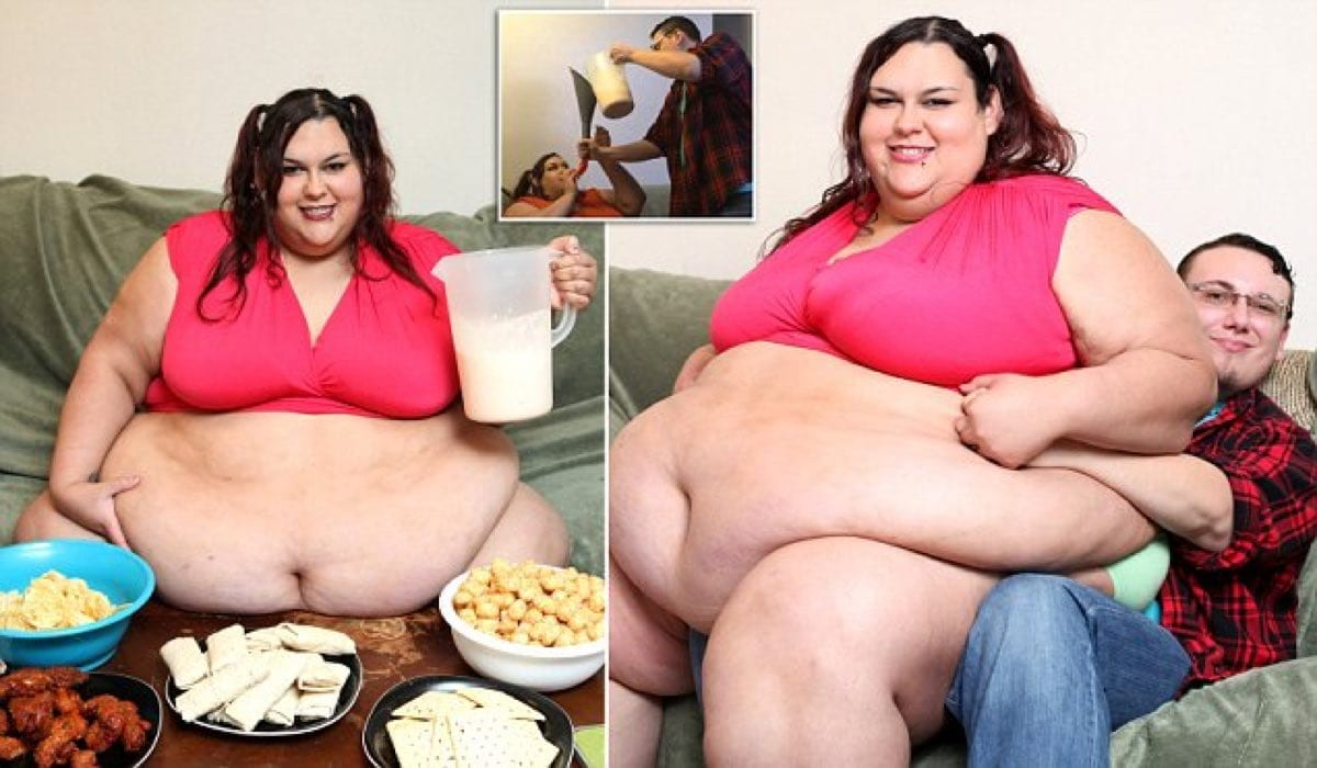 *** EXCLUSIVE - VIDEO AVAILABLE*** Monica posing in front of some snacks on August 21, 2016, in Fort Worth, Texas. Morbidly obese Monica Riley tips the scales at a whopping 50 stone. But rather than trying to lose weight, the 27-year-old, from Fort Worth, Texas, wants to continue to pile on the pounds Ò to the point where she is completely immobile. Monica, who models on Super Sized Big Beautiful Woman websites, is aiming to become the fattest woman in the world at 1000lbs Ò and wants to be so huge that she is literally bed-bound. Her feeder boyfriend, Sid Riley, 25, spends his days cooking for Monica, rolling her over when her 91-inch stomach is full and funnel feeding her through a tube. PHOTOGRAPH BY Ruaridh Connellan / Barcroft Images London-T:+44 207 033 1031 E:hello@barcroftmedia.com New York-T:+1 212 796 2458 E:hello@barcroftusa.com New Delhi-T:+91 11 4053 2429 E:hello@barcroftindia.com www.barcroftimages.com